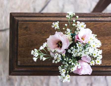 flowers on a coffin