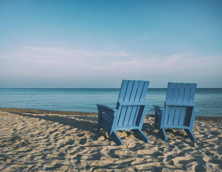 Two blue chairs representing retirement