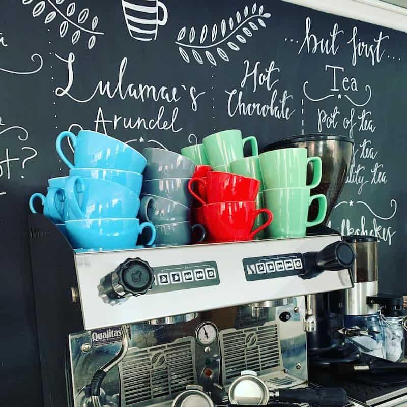 coffee cups on coffee machine
